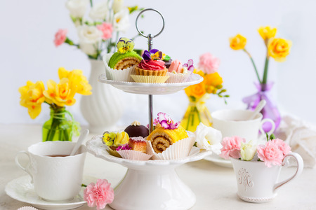 tea and biscuits: Assorted cakes and pastries on a cake stand for afternoon tea