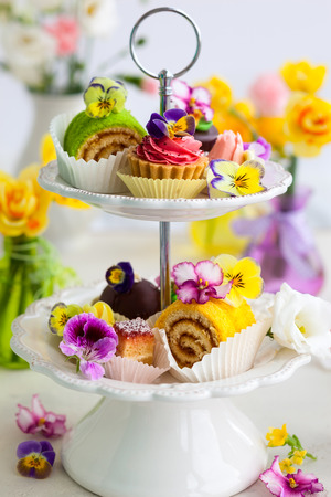 dessert stand: Assorted cakes and pastries on a cake stand for afternoon tea
