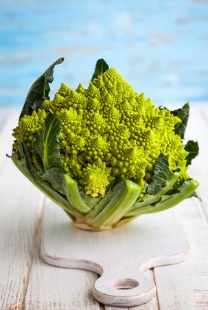 head of cauliflower: A head of Romanesco broccoli on on chopping board Stock Photo
