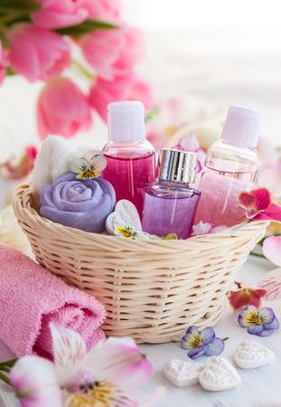 Spa bath toiletries set in basket with fresh flowers