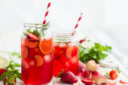 rhubarb: Preparation homemade refreshing  strawberry,lime and rhubarb lemonade with mint Stock Photo