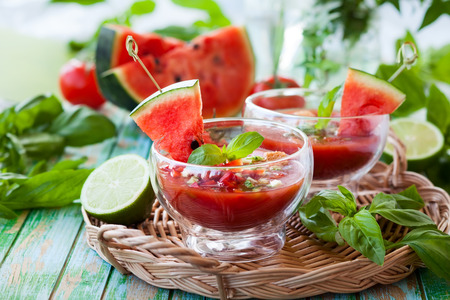 Watermelon tomato gazpacho in  glass bowls Standard-Bild