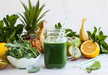 meal preparation: Fresh kale fruit smoothie in a jar with ingredients Stock Photo