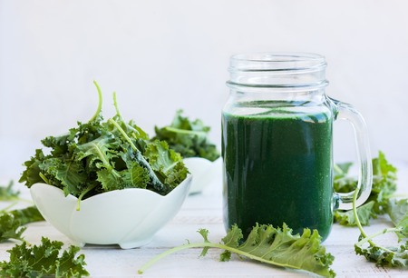 A healthy green kale smoothie with spirulina Stock Photo