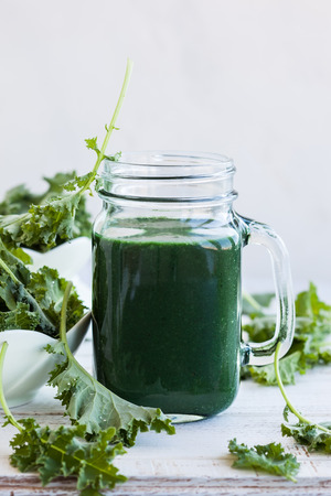 chlorophyll: A healthy green kale smoothie with spirulina Stock Photo
