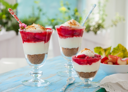 No bake rhubarb and strawberry cheesecakes in glasses