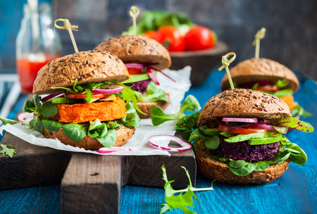 vegetarian hamburger: Veggie beet and carrot burgers with avocado