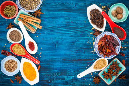 asian cuisine: Various asian spices  on a blue wooden background. Top view
