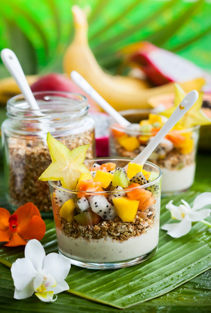 dragon vertical: Healthy breakfast with exotic fruits yogurt and granola