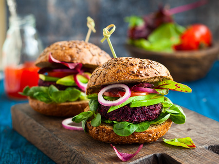 Veggie beet and quinoa burger with avocado Stock Photo