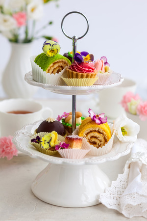 tartlet: Assorted cakes and pastries on a cake stand for afternoon tea