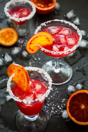 Blood Orange Margarita in glass with salted rim