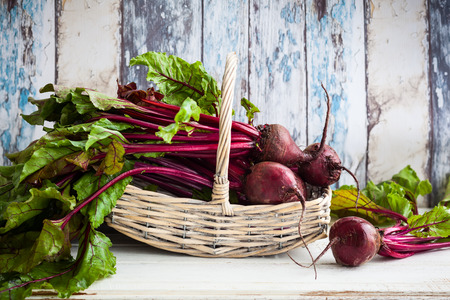 basket: Fresh organic beetroot with green leaves in a basket