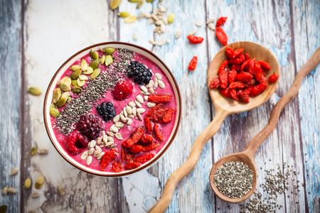 blackberry fruit: Breakfast berry smoothie bowl topped with goji berriesraspberry blackberry pumpkin sunflower and chia seeds.