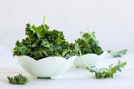 Fresh green kale leaves in  bowl 写真素材