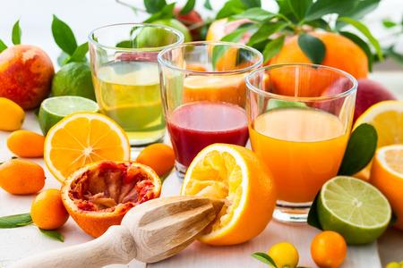 citrus: Different fresh citrus juices