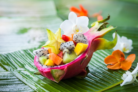Exotic fruit salad served in half a dragon fruit