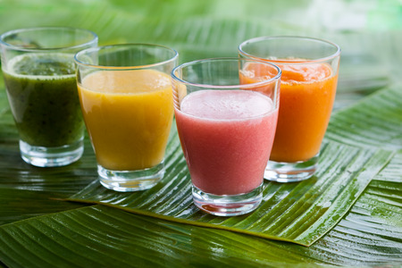 thai dessert: Assortment of fresh  tropical fruits smoothies on the green banana leaves