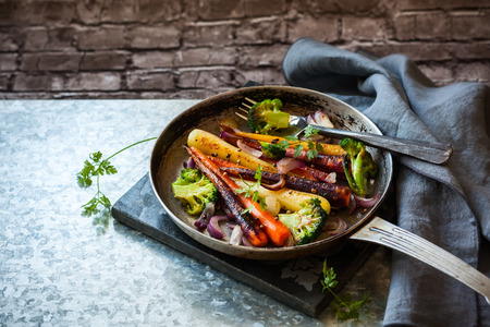 pan: roasted rainbow carrot and broccoli in a vintage pan, rustic style