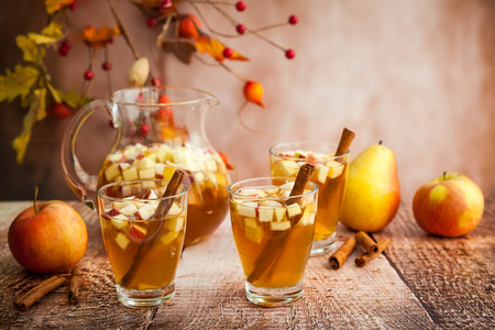 yellow apple: Autumn  sangria with apples,pears and cinnamon Stock Photo