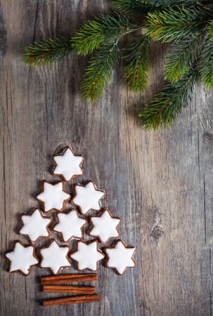 gingerbread cookies: Christmas background with gingerbread cookies,fir branches and spices on the old wooden board