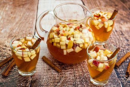 Autumn  sangria with apples,pears and cinnamon Stock Photo