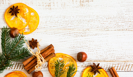 Christmas decoration with fir branches,star anise,cinnamon stick,nuts and slices of dried oranges