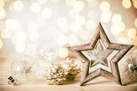 Christmas background with decorative star,Christmas balls and pine cones