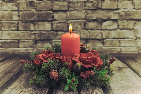 table decoration: Christmas table decoration with burning red candle