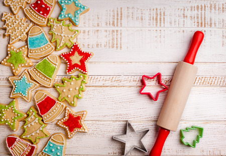 holiday food: Christmas cookies, rolling pin and cookie cutters on the wooden background