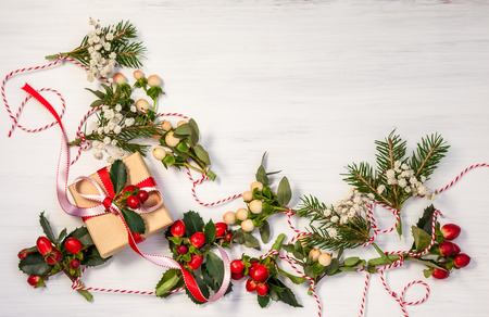 Christmas presents and winter natural garlands on the white wooden background