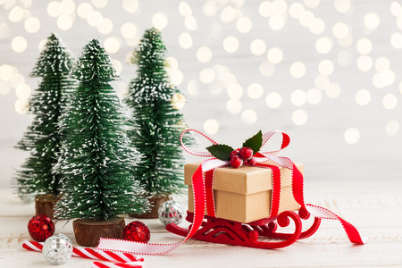 Christmas present on the sledge and festive decor 写真素材