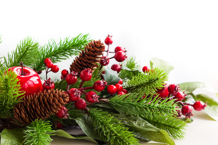 christmas tree decoration: Christmas decoration with fir tree, pine cones, red apples and holly berries