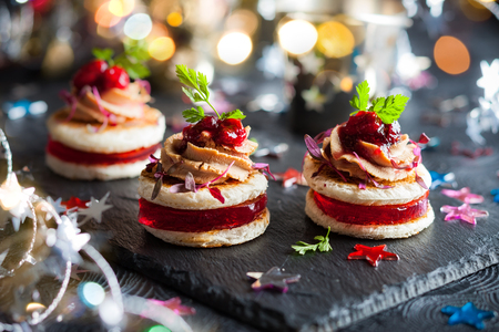 buffet dinner: Festive appetizer with foie gras, cranberry chutney and jelly Stock Photo