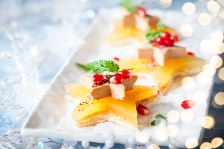 Foie gras and orange aspic on star-shaped toasts 免版税图像