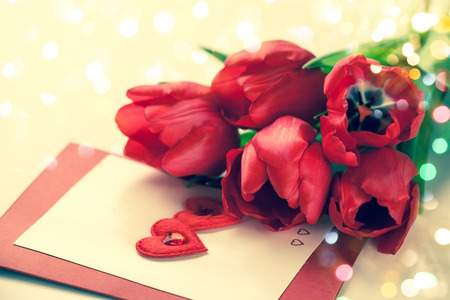 valentine heart: Red tulips and greeting card with hearts for Valentines Day