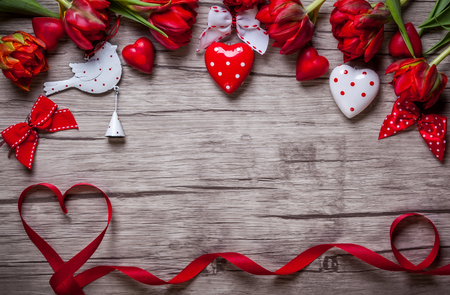 mother day: Valentines Day background with chocolates, hearts and red tulips