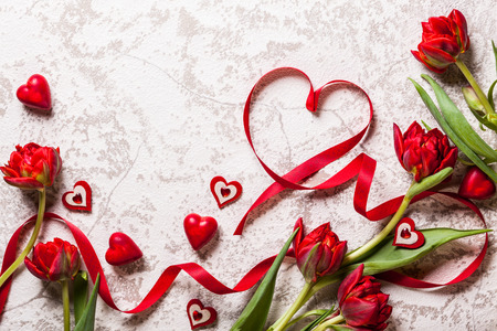 happy day: Valentines Day background with hearts and red tulips Stock Photo