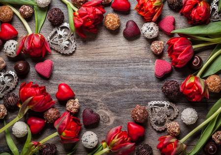 Gourmet chocolates and red tulips for Valentines Day Stock Photo