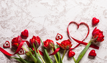 nobody: Valentines Day background with hearts and red tulips Stock Photo