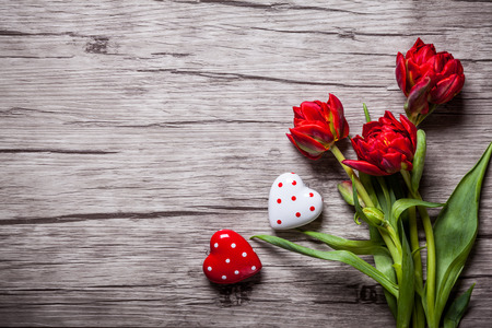 Valentines Day background with hearts and red tulips Stock Photo