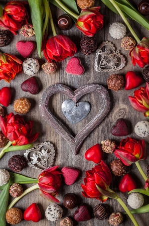 red tulip: Gourmet chocolates and red tulips for Valentines Day Stock Photo