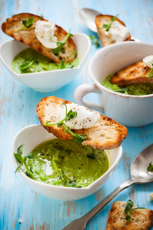 green pea: Green pea soup with goats cheese crostini Stock Photo