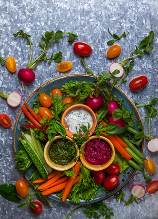 crudite: Veggie crudite platter with three different dips on the metal background Stock Photo