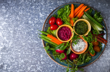 crudite: Veggie crudite platter with three different dips on the metal background Stock Photo