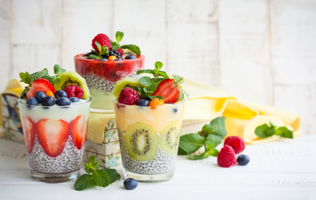 clean dishes: Layered berry and chia seeds smoothies Stock Photo