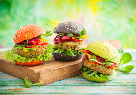 Red, green, black mini burgers with quinoa and vegetables
