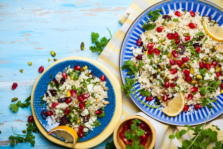vegan: Cauliflower couscous with dried cranberry, pomegranate, pistachio and pine nut