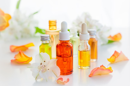 aromatic: Bottles of essential aromatic oils and fresh flowers Stock Photo
