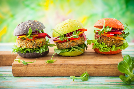 Red, green,black mini burgers with quinoa and vegetables Stock fotó